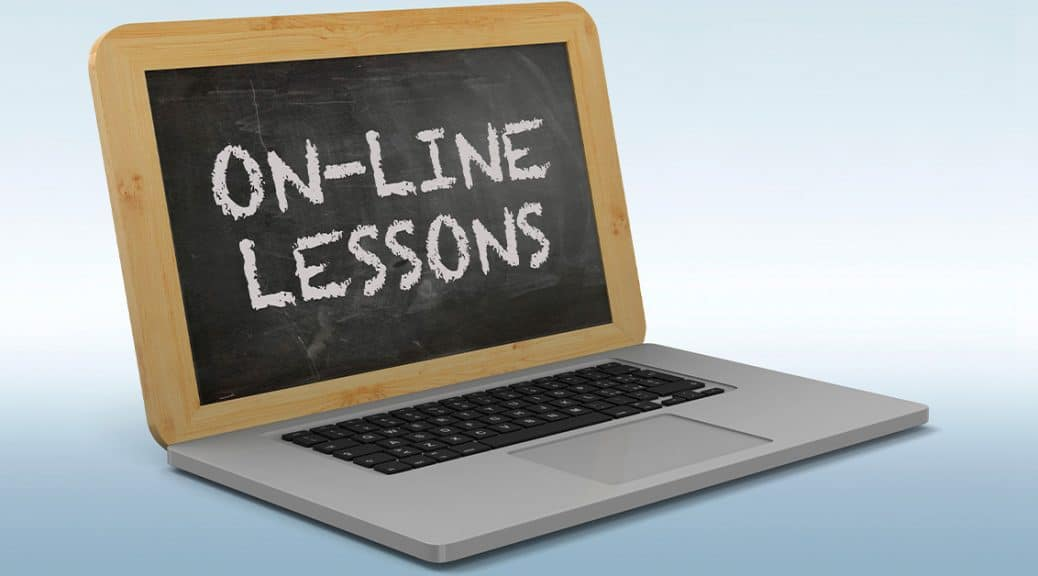 """Laptop with a chalkboard instead of a screen. """"On-Line Lessons"""" is written on the chalkboard."""